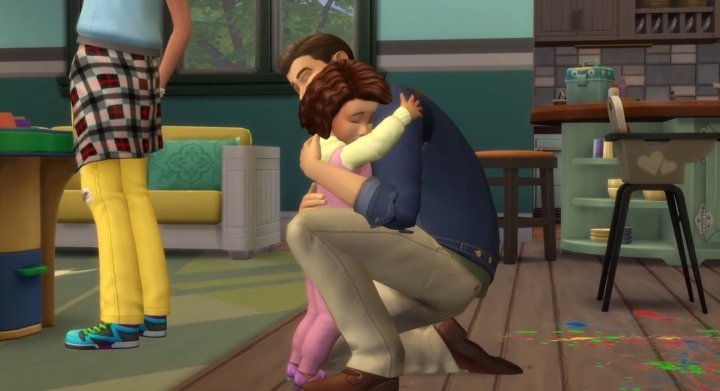 The Sims 4 Parenthood Game Pack: A daddy hugs his daughter in the DLC