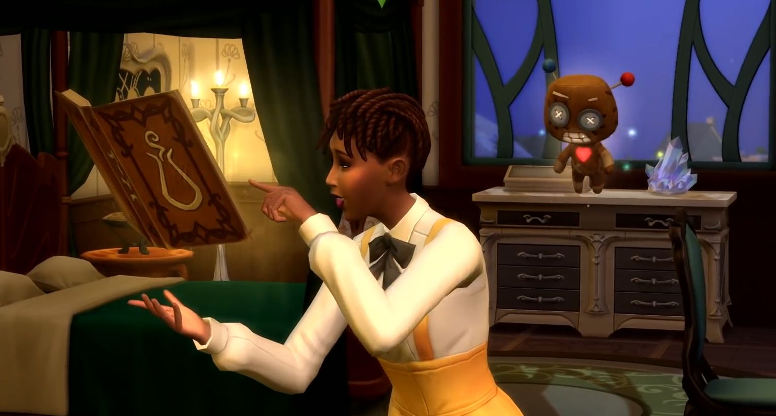 A sim learns a magic spell in The Sims 4 Realm of Magic